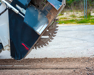 Milling drum for road milling machine. Milling of asphalt for road reconstruction accessory for skid steer
