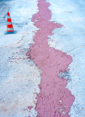 Filling with colored concrete of excavation with a narrow section for the implementation of a fiber optic distribution network for telecommunications.