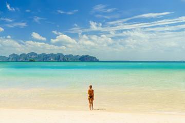 woman sunbathing  on the tropical beach