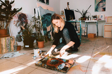portraits of a female artist painter in her atelier