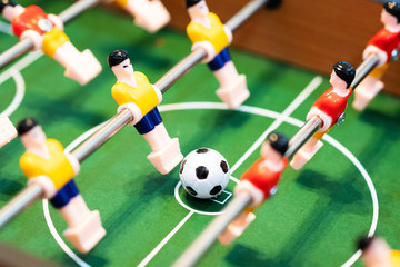 Foosball table soccer. football player, sport concept