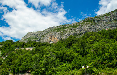 Monastery Ostrog placed on vertical rock of Ostroska Greda, Montenegro