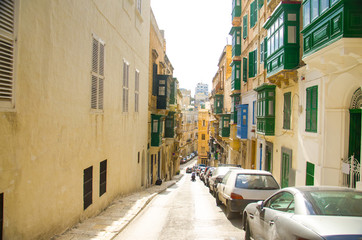 Narrow streets and yellow buildings in Valletta, Malta