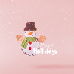 Christmas concept.  Creative Christmas conception made by falling in air christmas cuddly snowman toy