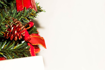Christmas tree on light background. New Year Card.
