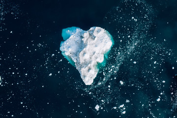 Minimalistic aerial view of a heart shaped iceberg in Greenland