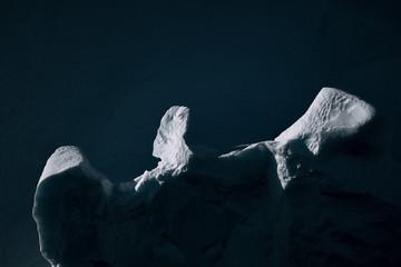 Minimalist ice berg illuminated by the sun