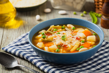 Minestrone soup with pasta and cheese.