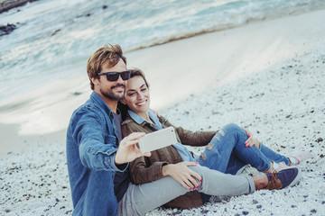 Boyfriends making selfie in beach