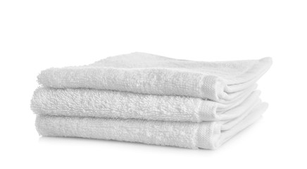 Stack of clean towels on white background