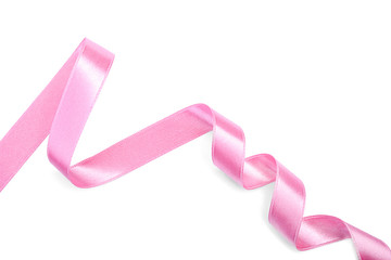 Curled pink ribbon on white background