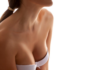 cleavage of women with beautiful breasts on a white background