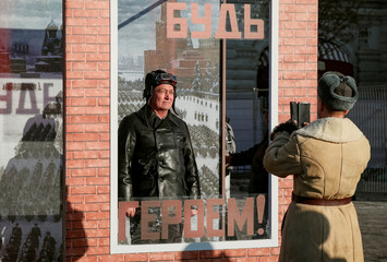 Participants take picture at a photo booth after a military parade in Red Square in Moscow