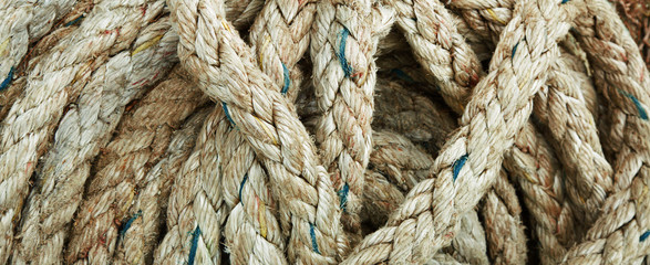 Close-up of an old frayed boat rope as background
