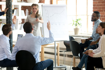 Female mentor or trainer invite willing male worker come to flipchart present idea, diverse colleagues brainstorm at training show activity taking part in teambuilding meeting. Cooperation concept