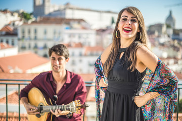 Beautiful fado singer performing with handsome portuguese guitarist player, Portugal