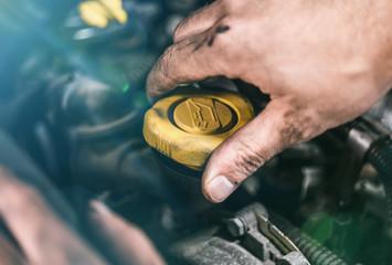 Fotobehang - Auto mechanic working in garage. Repair service.