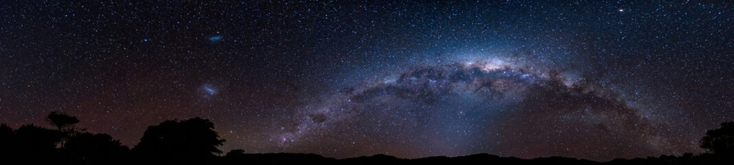 Fond de hotte en verre imprimé Univers Panorama Starry night Milky way over the mountain. Abel Tasman National Park.