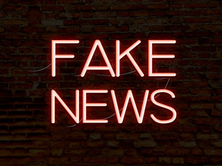 Fake News Red Neon Sign. Background texture of rustic brick wall old red orange