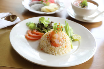 Fried rice with shrimp on wooden table