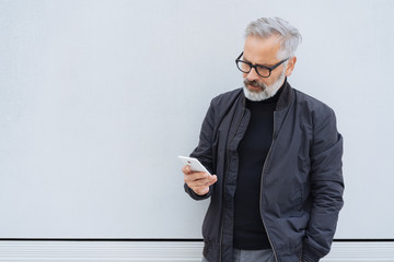 Middle-aged man looking worried at his mobile