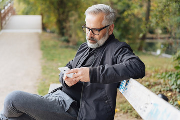 Attractive mature man relaxing on a park bench