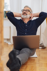 Middle-aged man daydreaming during work from home