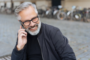 Senior man listening to a mobile phone call