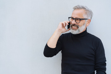 Attractive bearded man chatting on a mobile phone
