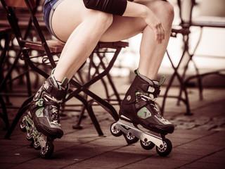 Woman riding roller skates