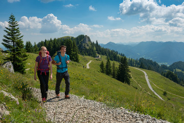 Germany, Bavaria, Brauneck near Lenggries, young couple hiking in alpine landscape