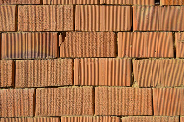 Brick wall of a small country house, ideal for backgrounds and textures.