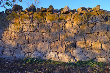 Old Stone wall which is made in a small village.