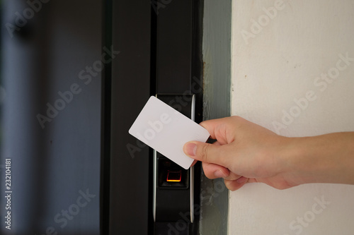 Door access control with a hand inserting key card to unlock