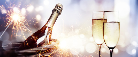 Cheers with a bottle of champagne for a new year