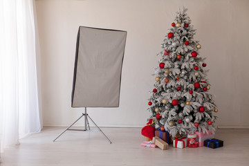White Photo Studio Christmas tree with red toys new year winter gifts decor
