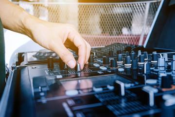 image of Dj playing music at mixer closeup