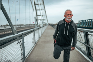 Fit looking older man warming up before exercise
