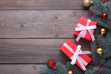 Christmas gifts presents with decorations on a grey background.