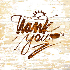 Thank you lettering on wooden background