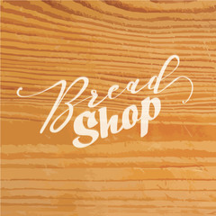 Bread shop lettering on wooden background
