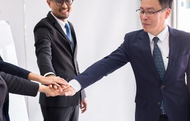 Asian business join hands success for dealing,Team work to achieve goals,Hand coordination