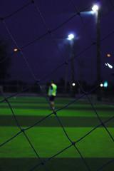 soccer ball on stadium at night