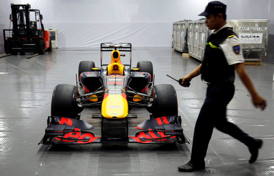 A security guard walks past Red Bull team's Formula One car during an event in Hanoi