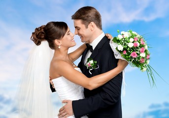 Bride and groom dancing  on background