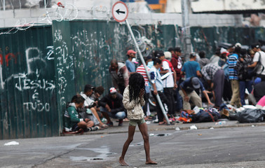 """Woman walks in """"Cracolandia"""", an abandoned site that has become a drug haven for addicts, ahead of a visit of members of Inter-American Commission on Human Rights, at Luz neighborhood in Sao Paulo"""