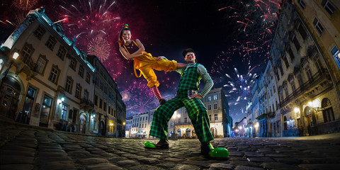 Night street circus performance whit clown, juggler. Festival city background. fireworks and Celebration atmosphere. Wide engle photo Wall mural
