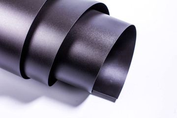black polyvinyl chloride roll on a white background
