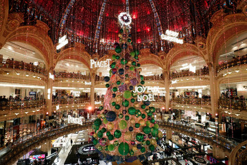 A giant Christmas tree stands on the day the Galeries Lafayette's department store lights were switched on for the festive season in Paris