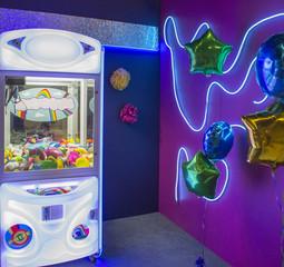 Crane claw machine with stuffed toys
